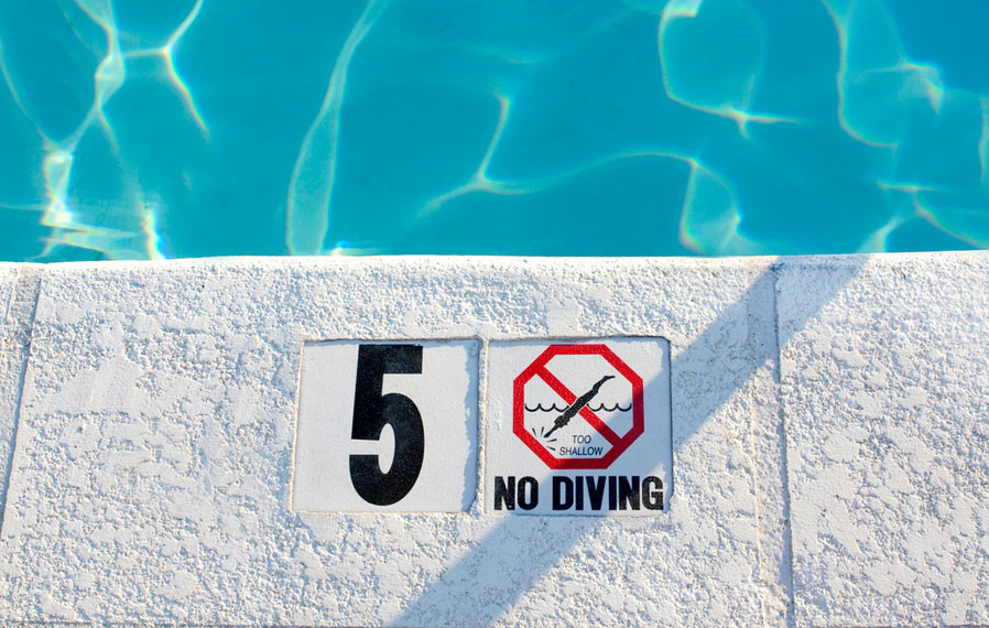 Up close shot of the pool's no diving sign.